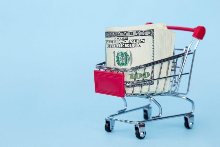 carrinho de compras com dólar dentro