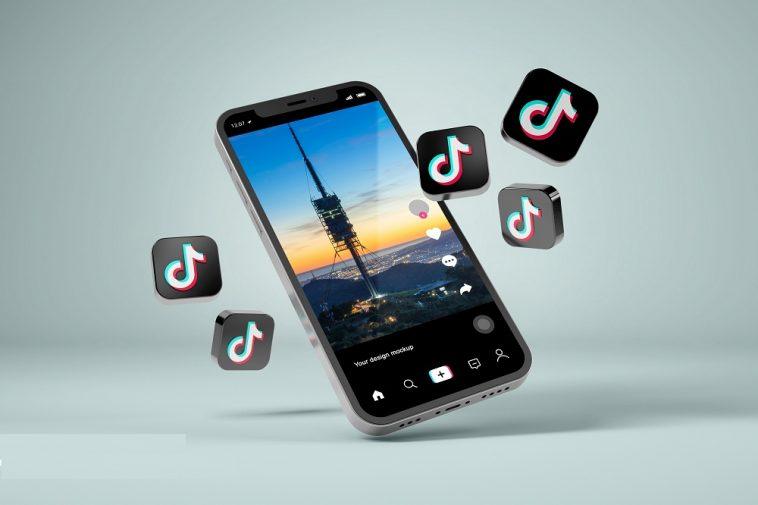 smartphone em fundo cinza mostrando a tela do aplicativo Tiktok, simbolizando como ganhar dinheiro no Tiktok